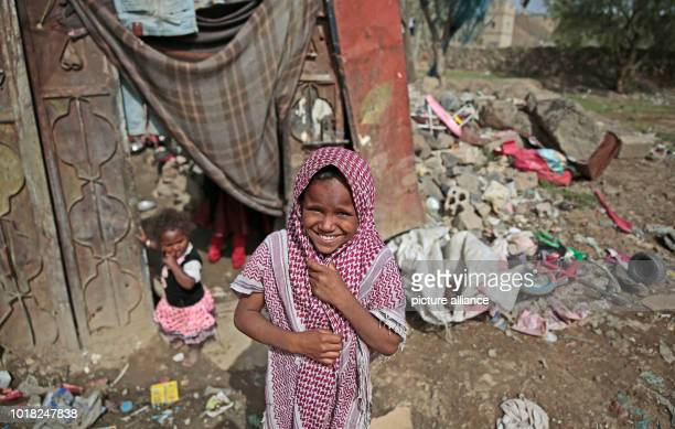 A Yemeni girl who was displaced from the coastal city of Al Hudaydah stands in front of a shelter where she lives with her family in Sanaa Yemen 17...