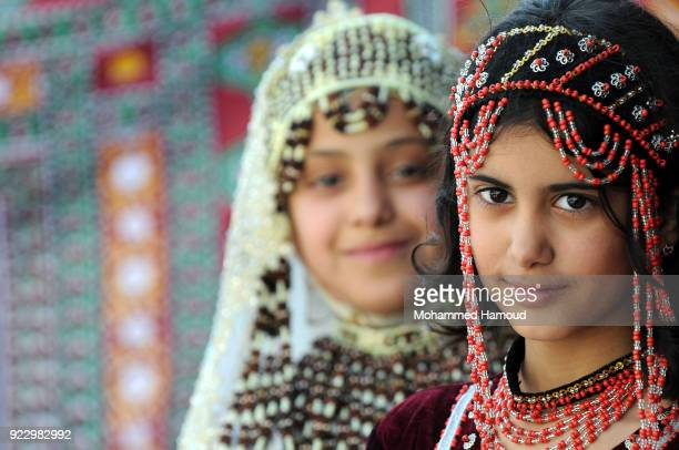 Yemeni girls wearing very traditional clothes take part in a fashion show held to call for peace and an end of the ongoing war on February 21 2018 in...