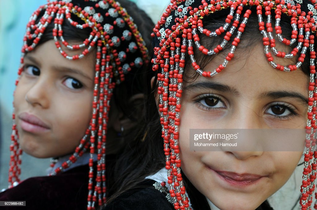 Yemeni girls wearing very traditional clothes take part in a fashion show held to call for peace and an end of the ongoing war on February 21, 2018 in Sana'a, Yemen.