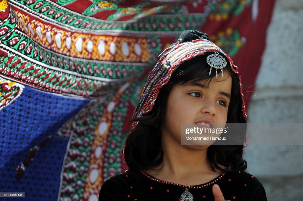 A Yemeni girls wearing very traditional clothes takes part in a fashion show held to call for peace and an end of the ongoing war on February 21, 2018 in Sana'a, Yemen.
