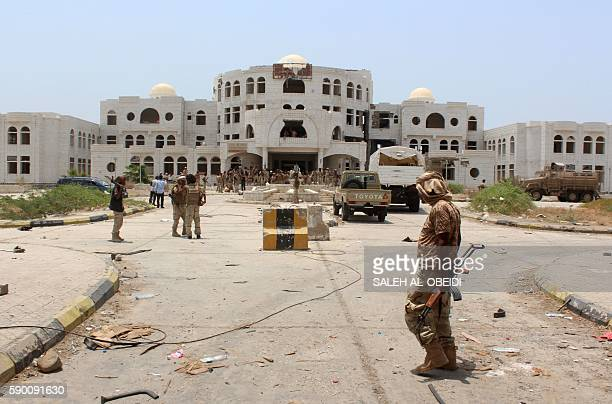 Yemeni government forces walk in Zinjibar on August 16 2016 after they entered the capital of the southern Abyan province following an offensive...