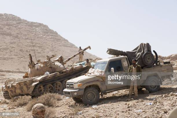 Yemeni government tank and truckmounted guns operate near the front line in the battle against Houthi rebels in the mountainous region outside Sana'a...