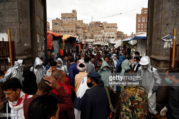 A Yemeni health worker fumigates people's hands at a market during a disinfection campaign on April 30 2020 in Sana'a Yemen Yemen reported its first...