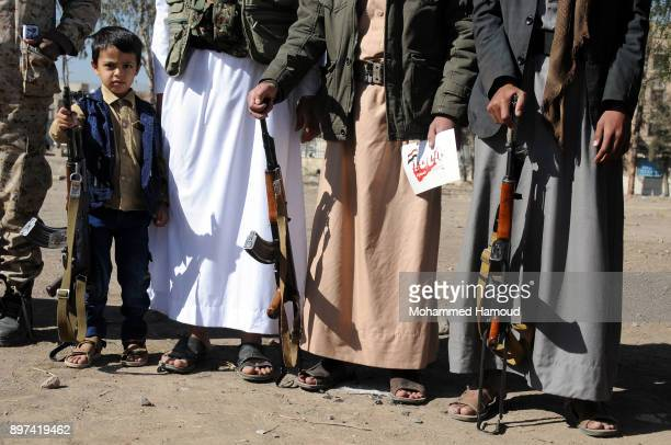 Yemeni Houthi members hold their refiles during a tribal gathering staged to congratulate the firing of a ballistic missile to Riyadh 1000days since...