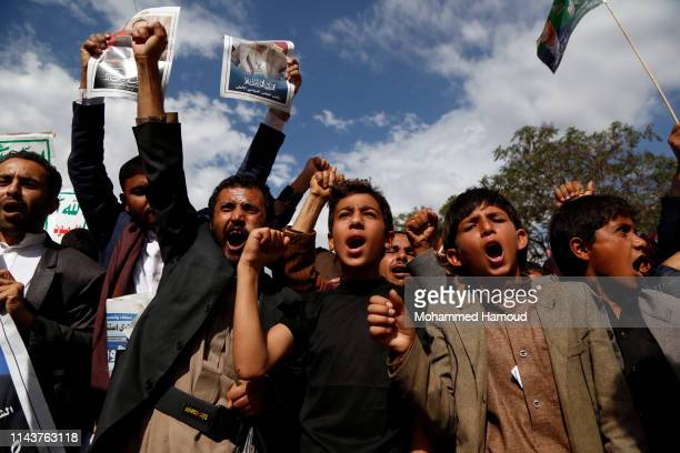 Yemeni Houthi Supporters shout slogans as they participate in a protest marking the first anniversary of the killing the head of the Houthis' Supreme...