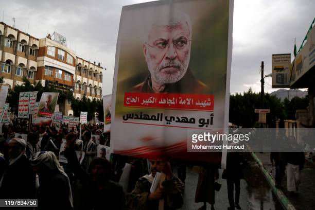 Yemeni Houthi-supporters take part in a protest against the killing of the Iranian commanders Qassem Soleimani and Abu Mahdi al-Muhandis by...