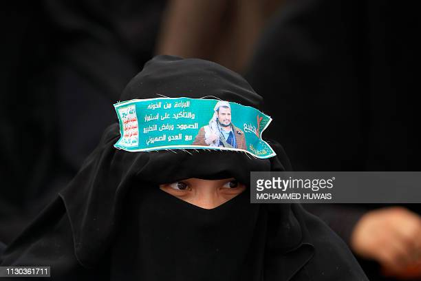 Yemeni Huthbi female protester looks on in the capital Sanaa on March 13 2019 during a rally Against Saudiled airstrikes two days before in the Kisar...