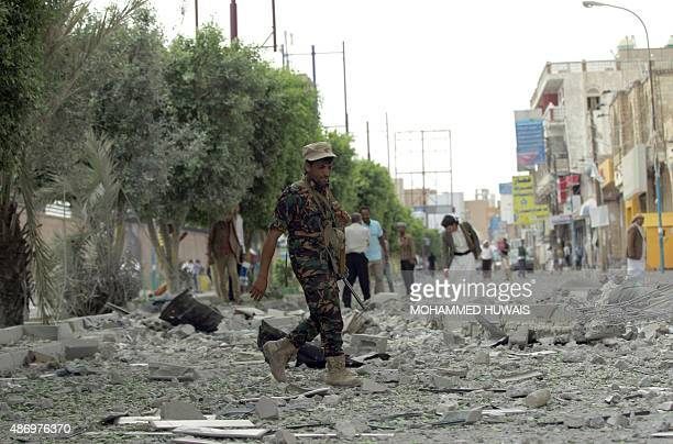 A Yemeni Huthi rebel walks amid debris following airstrikes by the Saudiled coalition in the capital Sanaa on September 5 2015 A Saudiled coalition...