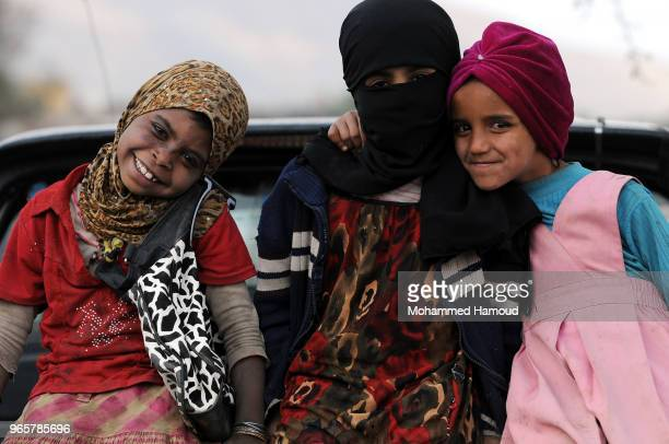 Yemeni internally displaced children pose at a displaced persons camp on May 30 2018 near Sana'a Yemen According to the UNHCR conflict in Yemen has...