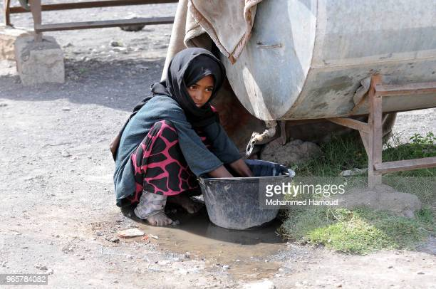 Yemeni internally displaced girl washes her clothes at a displaced persons camp on May 30 2018 near Sana'a Yemen According to the UNHCR conflict in...