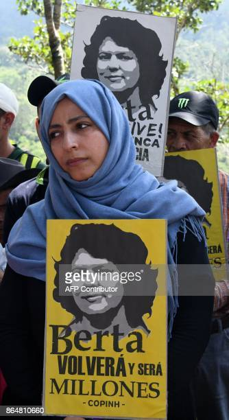 Yemeni journalist and Nobel Peace Prize laureate Tawakkol Karman holds a picture of activist Berta Caceres during a ceremony demanding justice for...