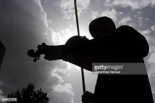 Yemeni learner plays violin as he attends free music lessons staged by the authorityrun Cultural Center in an attempt to alleviate difficult...