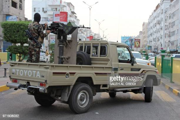 Yemeni loyalist fighters backed by Saudi Arabia and the United Arab Emirates patrol the streets of central Aden on June 11 2018 Forces hostile to...