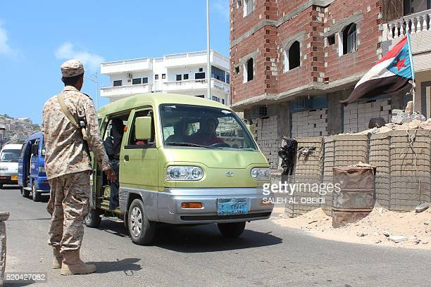 Yemeni loyalist forces man a checkpoint on a road in Aden's Tawahi neighbourhood on April 11 2016 A UNbrokered ceasefire was taking hold in Yemen...