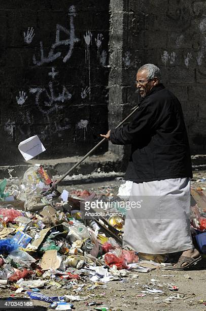 Yemeni man collects garbages from the streets during ongoing fuel shortage in Sanaa Yemen on April 19 2015 Cleaning services could not work due to...