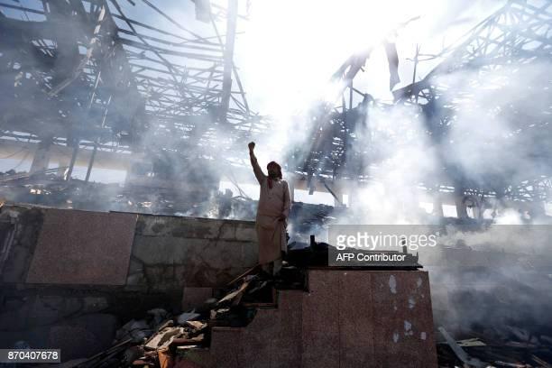 Yemeni man gestures at the site of an air strike in the capital Sanaa on November 5 2017 Yemen's rebelheld capital was struck by overnight air raids...