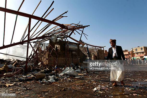 A Yemeni man inspects the damage at a sewing workshop that was hit by a Saudiled coalition air strike in the capital Sanaa on February 14 2016 The...