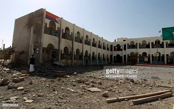 A Yemeni man inspects the damage following an airstrike carried out by the Saudiled coalition on a school and a bowling club in the capital Sanaa on...