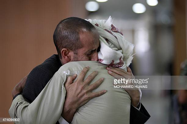 A Yemeni man is welcomed by a relative upon his arrival at the Sanaa international airport on May 20 after spending several days outside the country...