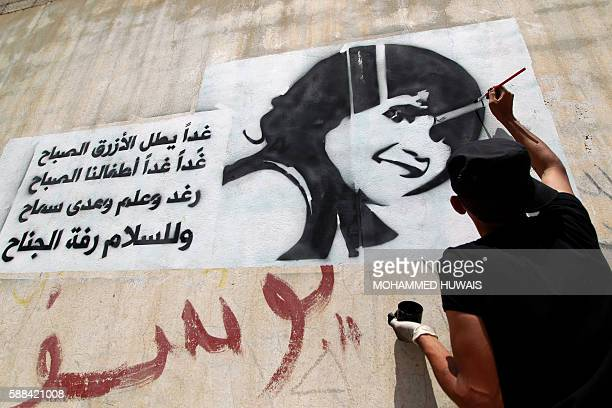 A Yemeni man paints the face of a child on a wall in the capital Sanaa on August 11 to raise awareness about the death and exploitation of children...