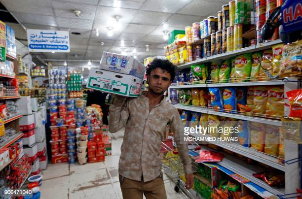 A Yemeni man shops at a supermarket in the capital Sanaa after the Yemeni currency rose 16 percent against the dollar on January 18 2018 For more...