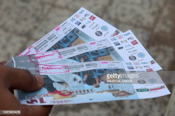 A Yemeni man shows tickets for the movie '10 Days Before the Wedding' in front of a cinema of the Southern city of Aden on September 13 2018 On...