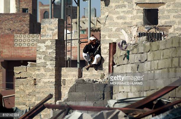 A Yemeni man sits amid the rubble of a sewing workshop after it was hit by a Saudiled coalition air strike in the capital Sanaa on February 14 2016...