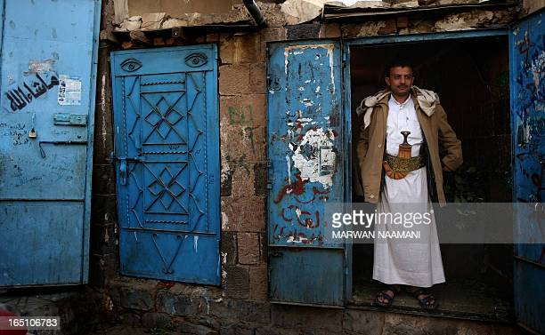 A Yemeni man stands at the entrance to his shop that sells qat a mild drug used daily by most Yemenis at a market in Sanaa on November 6 2009 The...
