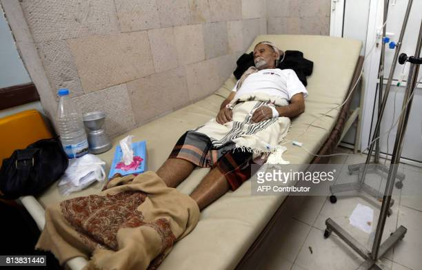 A Yemeni man suspected of being infected with cholera receives treatment at a makeshift hospital in Sanaa on July 13 2017 More than 320000 suspected...