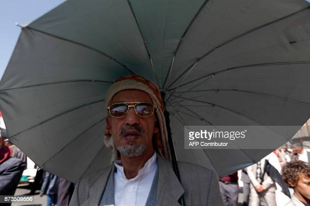 A Yemeni man takes part in a demonstration calling for the Saudiled coalition's blockade to be lifted on November 13 in the rebelheld capital Sanaa...
