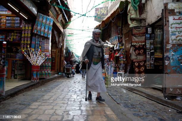 Yemeni man walks at a market on November 05, 2019 in Sana'a, Yemen.