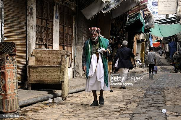 Yemeni man walks on a pavement as the peace talks organized in Kuwait continues in Sanaa Yemen on April 29 2016