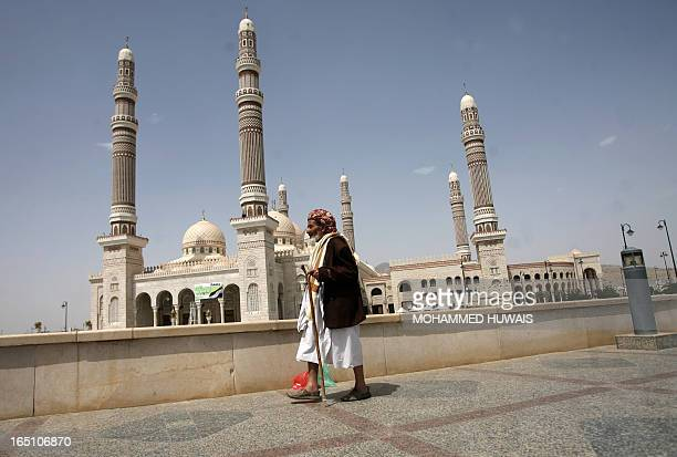 A Yemeni man walks past the alSaleh Mosque follwoing Friday noon prayers in the capital Sanaa on August 26 2011 Muslim believers the world over are...