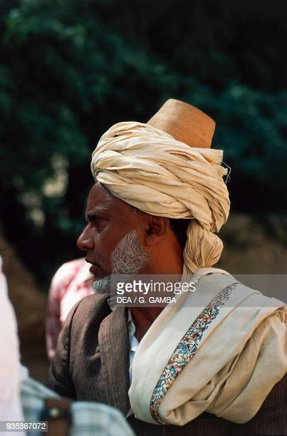 Yemeni man wearing an alqaweq and turban Zabid Al Hudaydah province Yemen