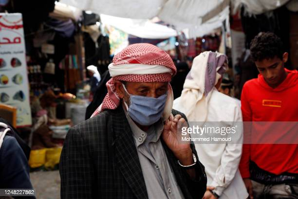 Yemeni man wears a protective face mask as a precautionary measure against the coronavirus' spread while doing shopping on June 08, 2020 in Sana'a,...
