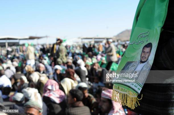Yemeni man wears a scarf painted with a picture of the Houthi leader Abd Almalik alHouthi as he during a gathering held to commemorate the birthday...