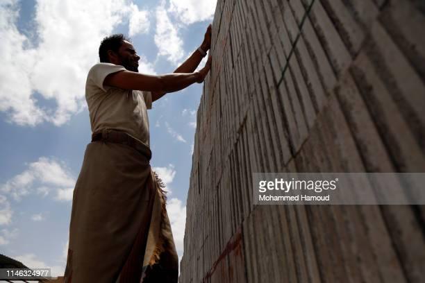 Yemeni man works on World Labour Day on May 01 2019 in Sana'a Yemen