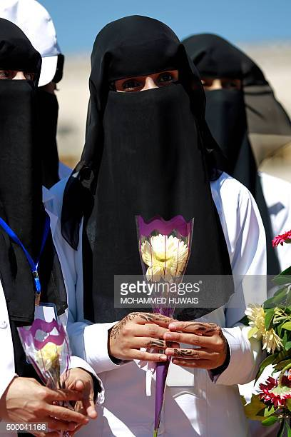 Yemeni medics hold flowers during a memorial ceremony marking the second anniversary of a deadly attack on the defence ministry on December 5 at a...