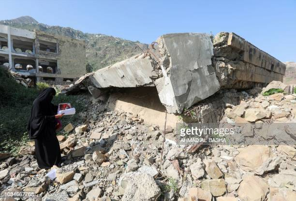 A Yemeni member of a school administration inspects the damage on the first day of the new academic year on September 16 at a school that was damaged...
