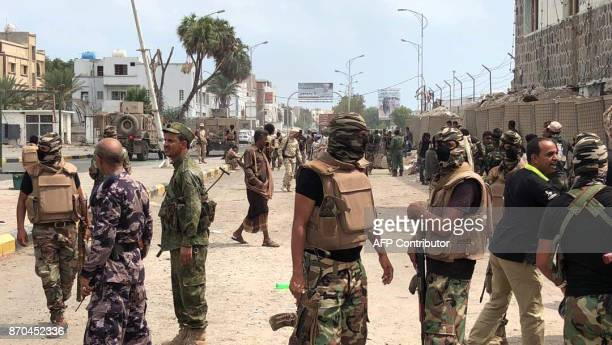 Yemeni men and security forces inspect the site of a suicide bombing in the southern port city of Aden on November 5 2017 AlQaeda suspects carried...