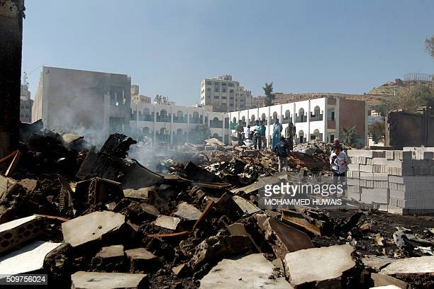 Yemeni men inspects the damage following an airstrike carried out by the Saudiled coalition on a school and a bowling club in the capital Sanaa on...
