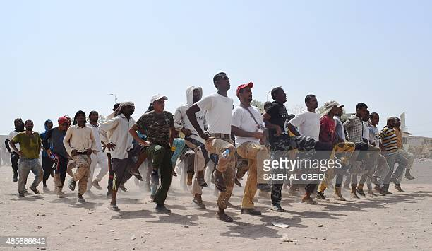 Yemeni men loyal to exiled President Abedrabbo Mansour Hadi take part in a military training in the city of Aden on August 29 2015 The Yemeni army...