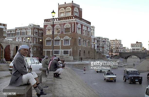 Yemeni men rest on cement benches in the old quarter of Sanaa 01 January 2004. Sanaa is the Arab cultural capital for 2004 during which a large...
