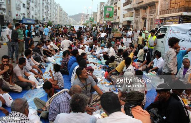Yemeni men share an Iftar meal during the holy fasting month of Ramadan on June 11 2018 in the southern port city of Aden