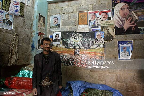 A Yemeni men stands inside a shop adorned with pictures of Yemeni President Ali Abdallah Saleh in Sanaa January 25 2010 The United States is set to...