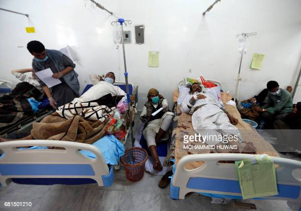 Yemeni men suspected of being infected with cholera receive treatment at a hospital in Sanaa on May 10 2017 Thirtyfour people have died of...