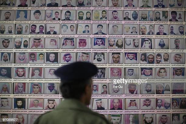 Yemeni military officer inspects photos of wanted Al Qaeda operatives from Saudi Arabia and Yemen in a military base on January 31, 2010 in Sana'a,...