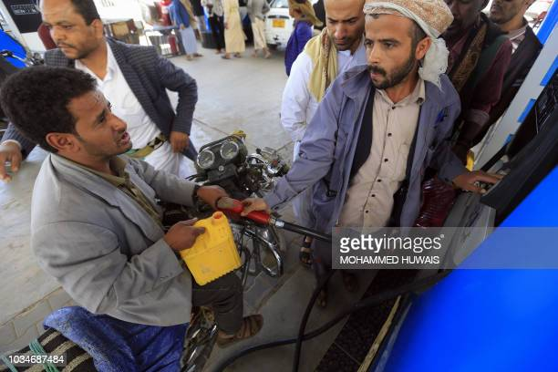 Yemeni motorcyclists gather at a petrol station amid fuel shortages in the capital Sanaa on September 17 2018 Saudi Arabia and its allies intervened...