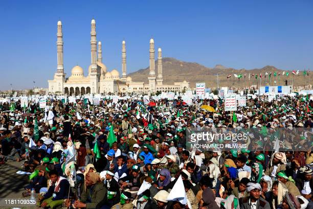 TOPSHOT Yemeni Muslims attend a gathering to celebrate the birth of Islam's Prophet Mohammed in the Yemeni capital Sanaa on November 9 2019