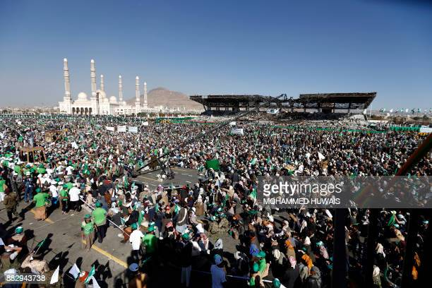 Yemeni Muslims attend a rally in front of AlSaleh mosque in the capital Sanaa on the occasion of the Prophet Mohammed's birthday on November 30 2017...